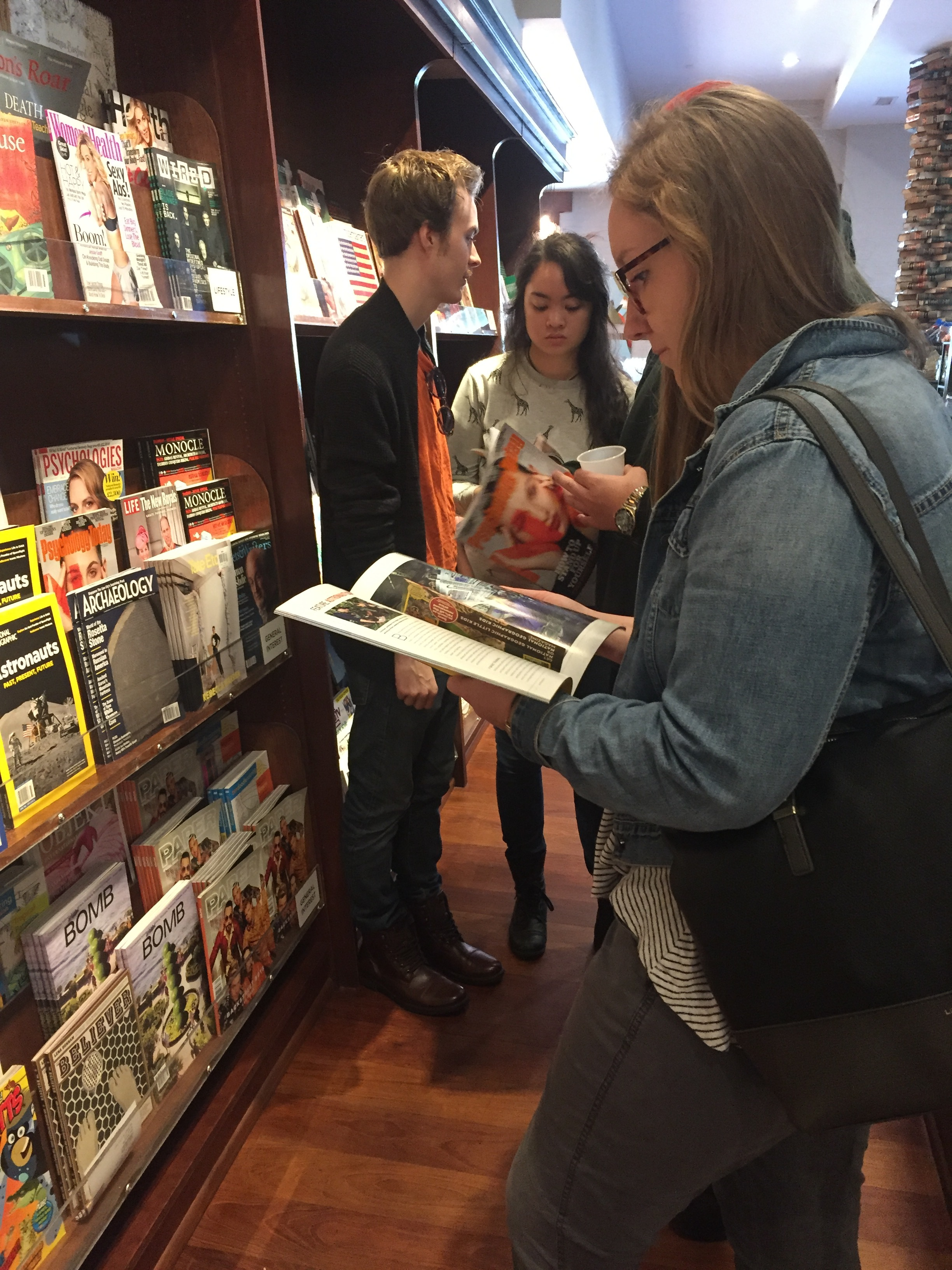 Our team at the bookstore analyzing magazine formatting for us to remember when designing our own with the final insights.