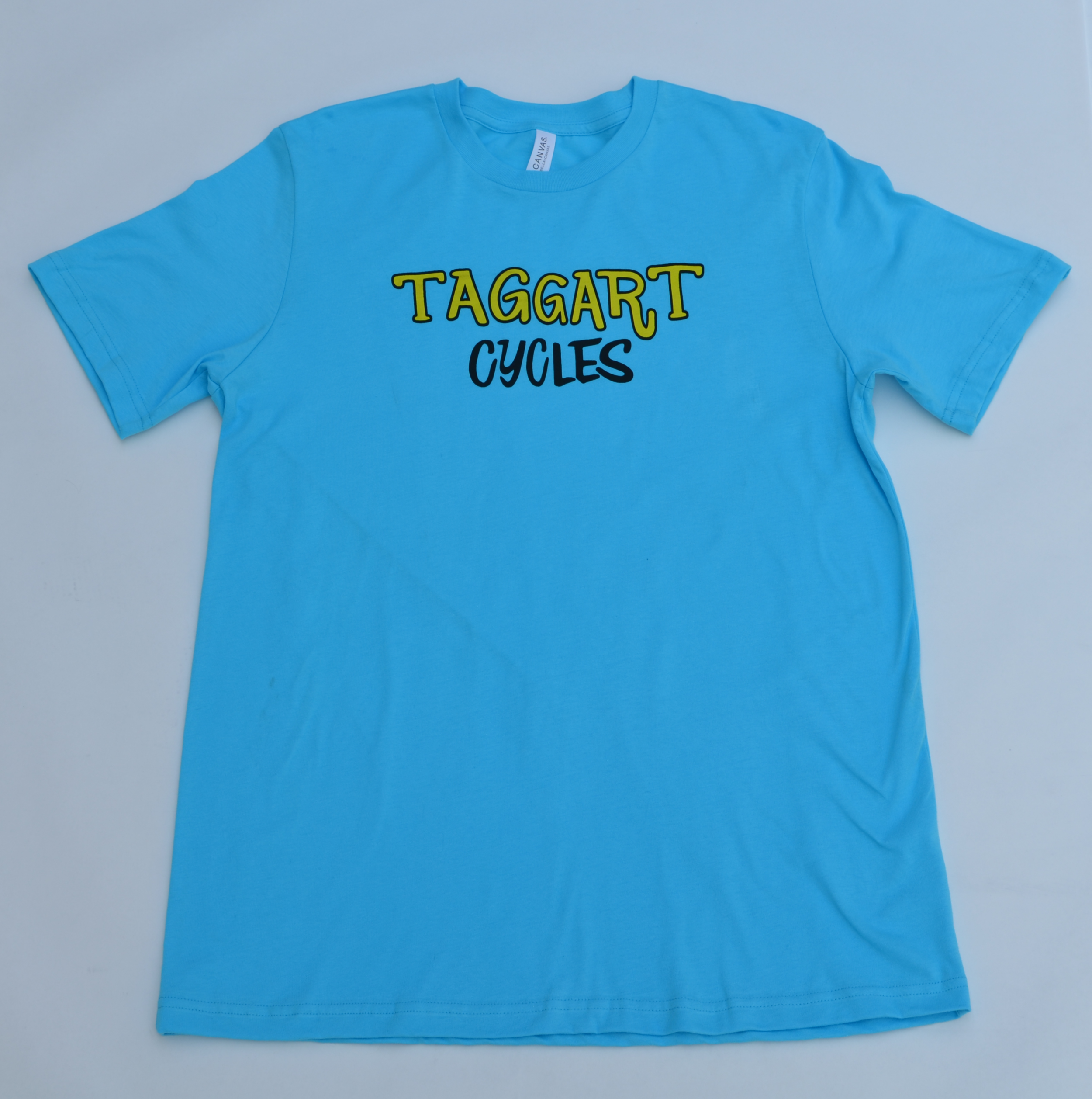 Logo T-Shirt - Are you into fancy bikes and having fun? Tell the world that you believe in the value of custom craftsmanship with your very own Taggart Cycles t-shirt. Shirts are high quality 100% cotton Bella + Canvas unisex cut t-shirts printed with non-fading, non-cracking water based ink. Head over to my Etsy shop to purchase.