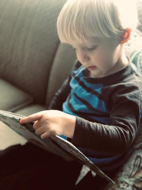 My son Luke reading an Usborne book