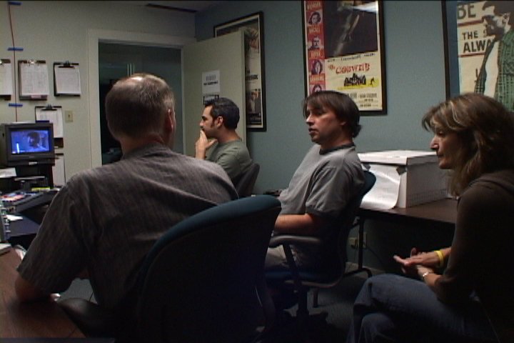 """Tom Hammond, Tommy Pallotta, Richard Linklater & Sandra Adair discussing """"A Scanner Darkly."""" This was at Rick's Detour Filmproduction offices when they were located on the north bound access lane of Interstate 35 near St Davids Hospital. (2006)"""