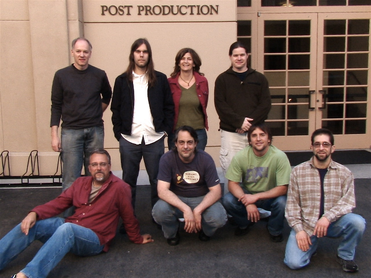 """Final mix for """"A Scanner Darkly.""""Outside Warner Brothers Burbank Stage 6.  [Top Left to Right]Tom Hammond, Grahm Reynolds (composer), Sandra Adair (picture editor), Jeremy Peirson (re-recording mixer)  [Bottom Left to Right]Skip Lievsay (re-recording mixer), Nic Ratner (music supervisor), Richard Linklater, Paul Berolzheimer (sound editor)   (2006)"""