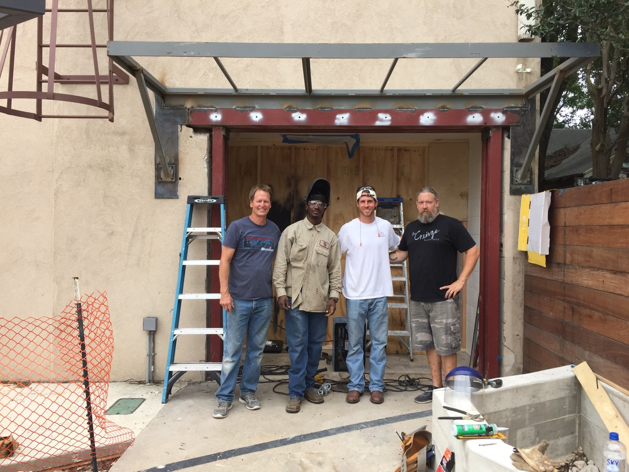 Last big construction obstacle was the front door and awning. The studio was constructed by Fred Willams Construction.  [left to right] Bobby Layne (lead carpenter), John Reginald (welder), Aaron Somers (apprentice carpenter), Matt Dunnam (lead carpenter)(May 2017)