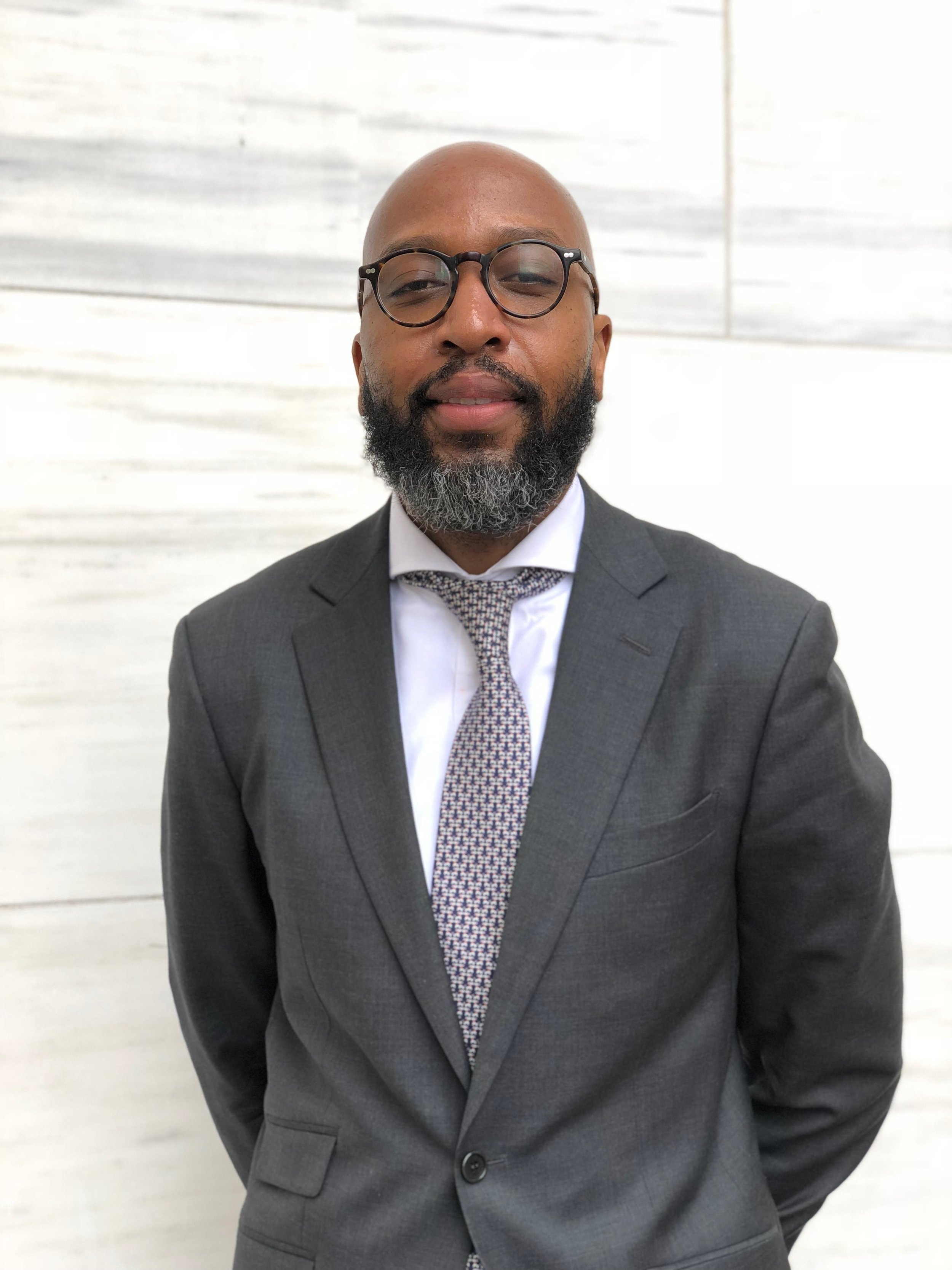 Dwane Omar Jones   Dwane Omar Jones specializes in commercial real estate investments and ground-up development. Mr. Jones earned his MBA from the NYU Leonard N. Stern School of Business where he was a Management Leadership for Tomorrow Fellow, Robert Toigo Foundation Fellow, and Consortium for Graduate Study in Management Fellow. He previously worked as a corporate attorney at a large NYC law firm on corporate reorganization matters. Mr. Jones earned his JD from Howard University School of Law where he was a Howard University School of Law Merit Scholar, and won the CALI Excellence for the Future Award in Contract Law. Mr. Jones earned his BS from the Zarb School of Business at Hofstra University. He is the President of the Howard University School of Law Alumni Club of New York, Fellow with the NYU Stern School of Business Center, Chair of the Board of Directors of A Better World Community Development Corporation of Emmanuel Baptist Church in Brooklyn, and member of the New York State Bar.