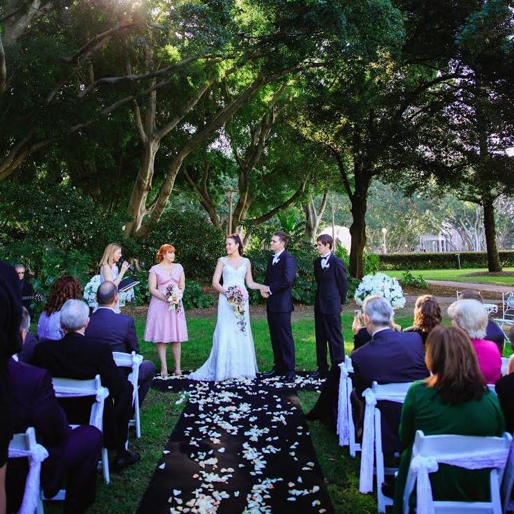 Black_carpet_with_ fresh_rose_petals_aisle_outddor_weddings.jpg