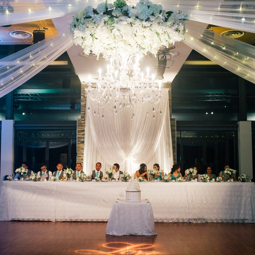 floral_wreath_chandelier_suspending_ceiling_wedding_styling.jpg