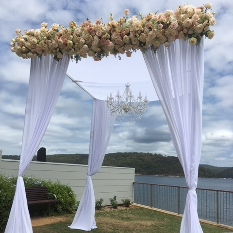 wrough_iron_chandeliers_suitable_outddor_wedding_floral_canopy.JPG