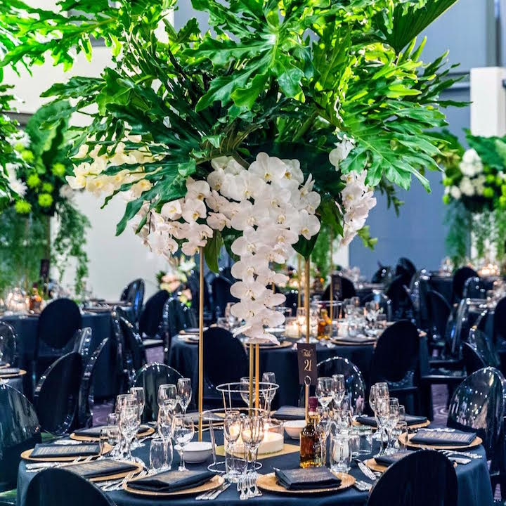 Waterview - Entire Venue - Guest table centrepiece, customised gold stand with florals and candle.jpg