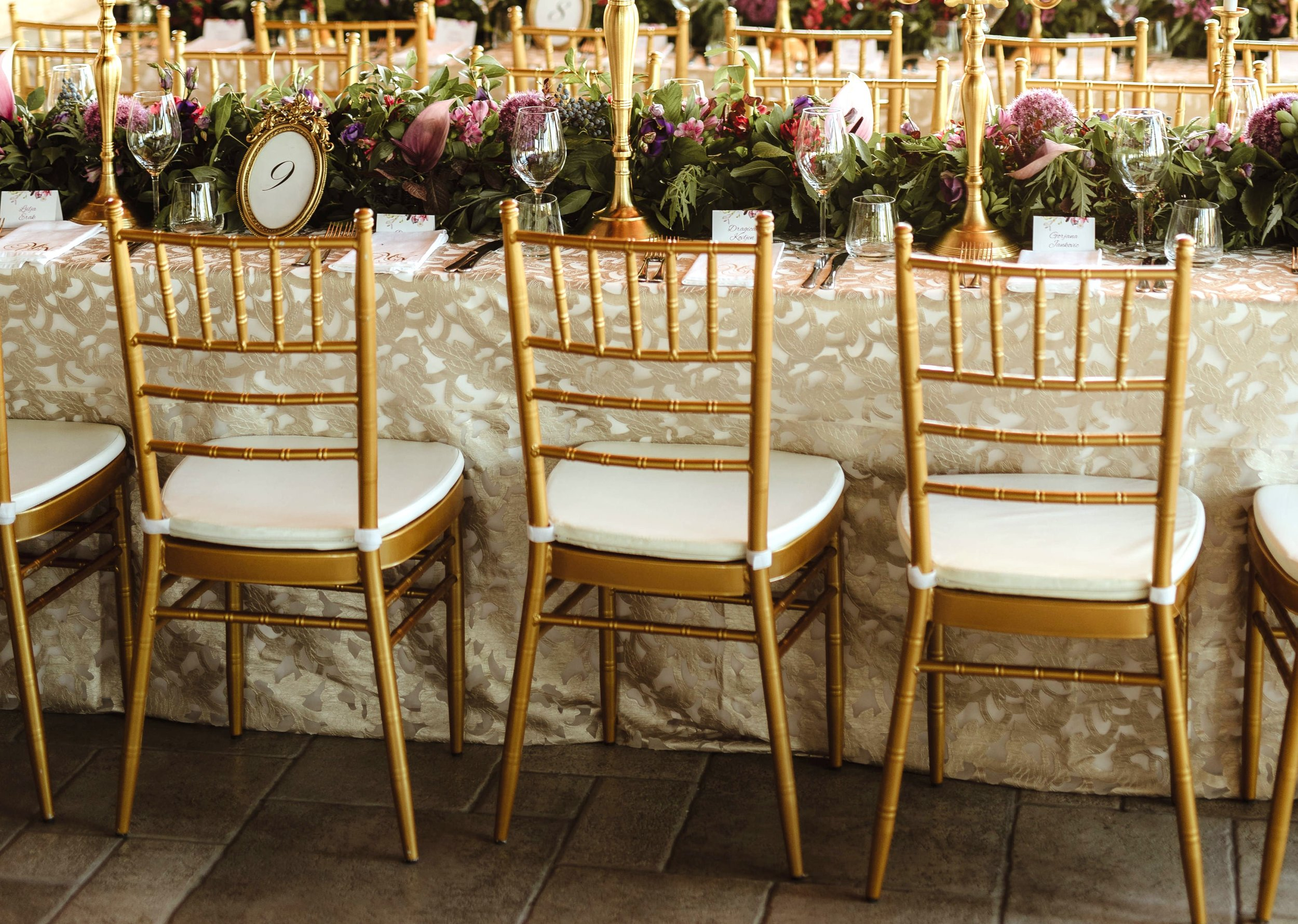 gold_tiffany_chairs_wedding_styling_luxury_linen.jpg