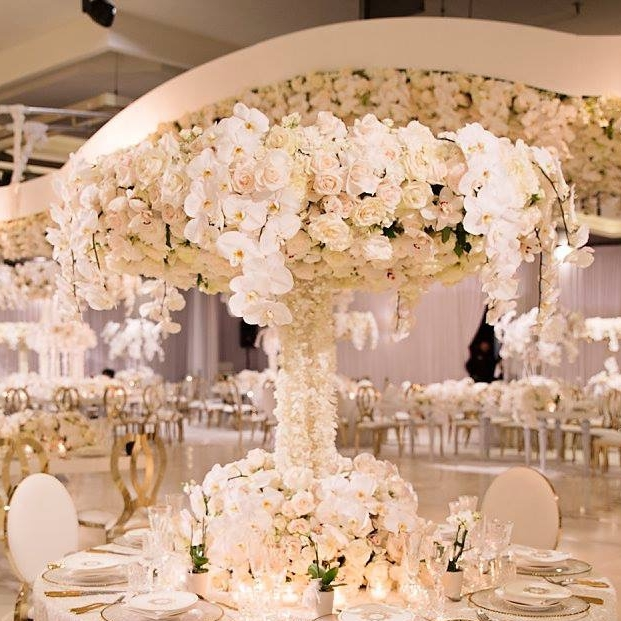 Le Montage - White Paisley luxury linen, custom floral stand and tree trunk structure.JPG