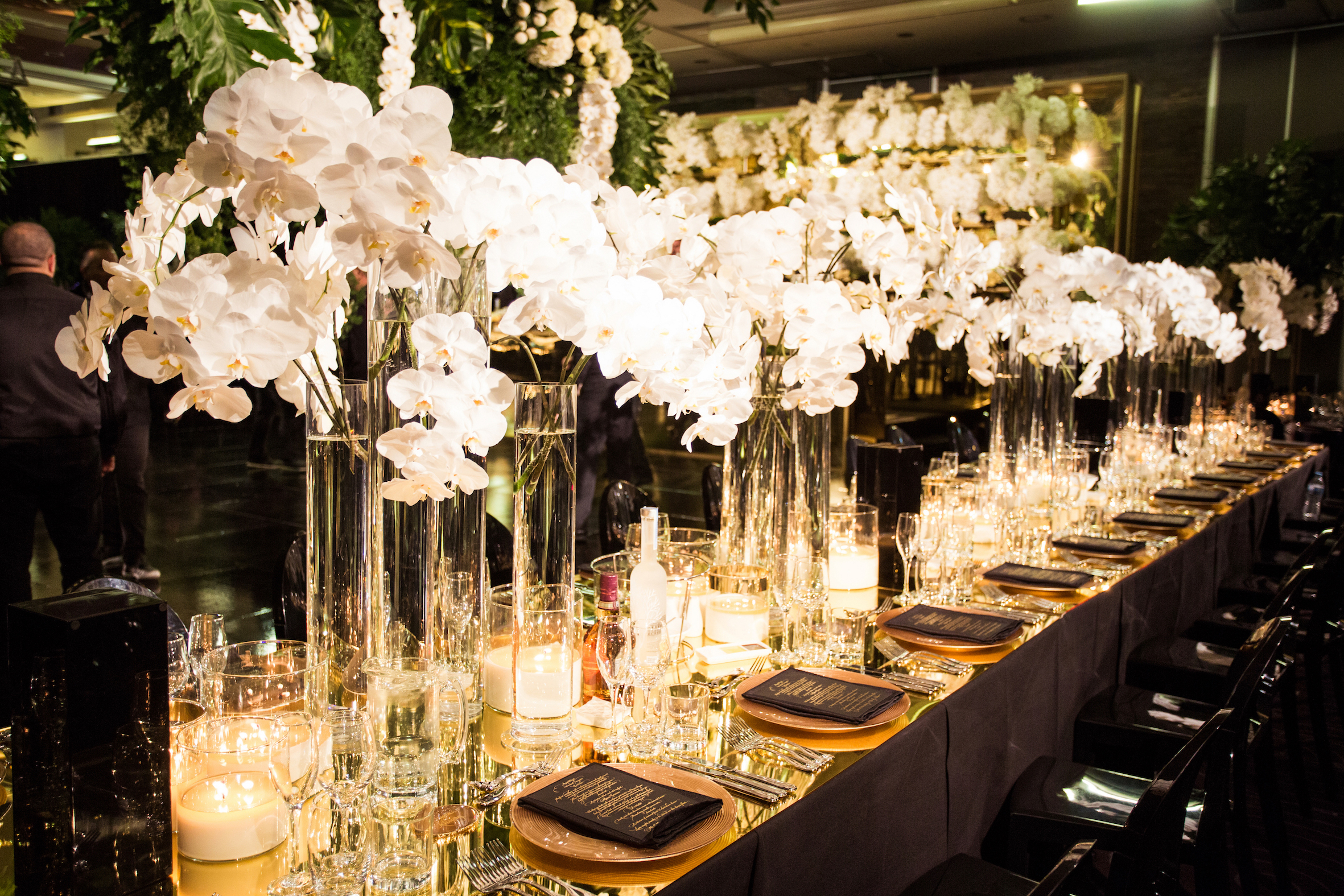 waterview_gold_mirror_table_top_orchids_centrepiece_black_green_cahrger_plates.jpg
