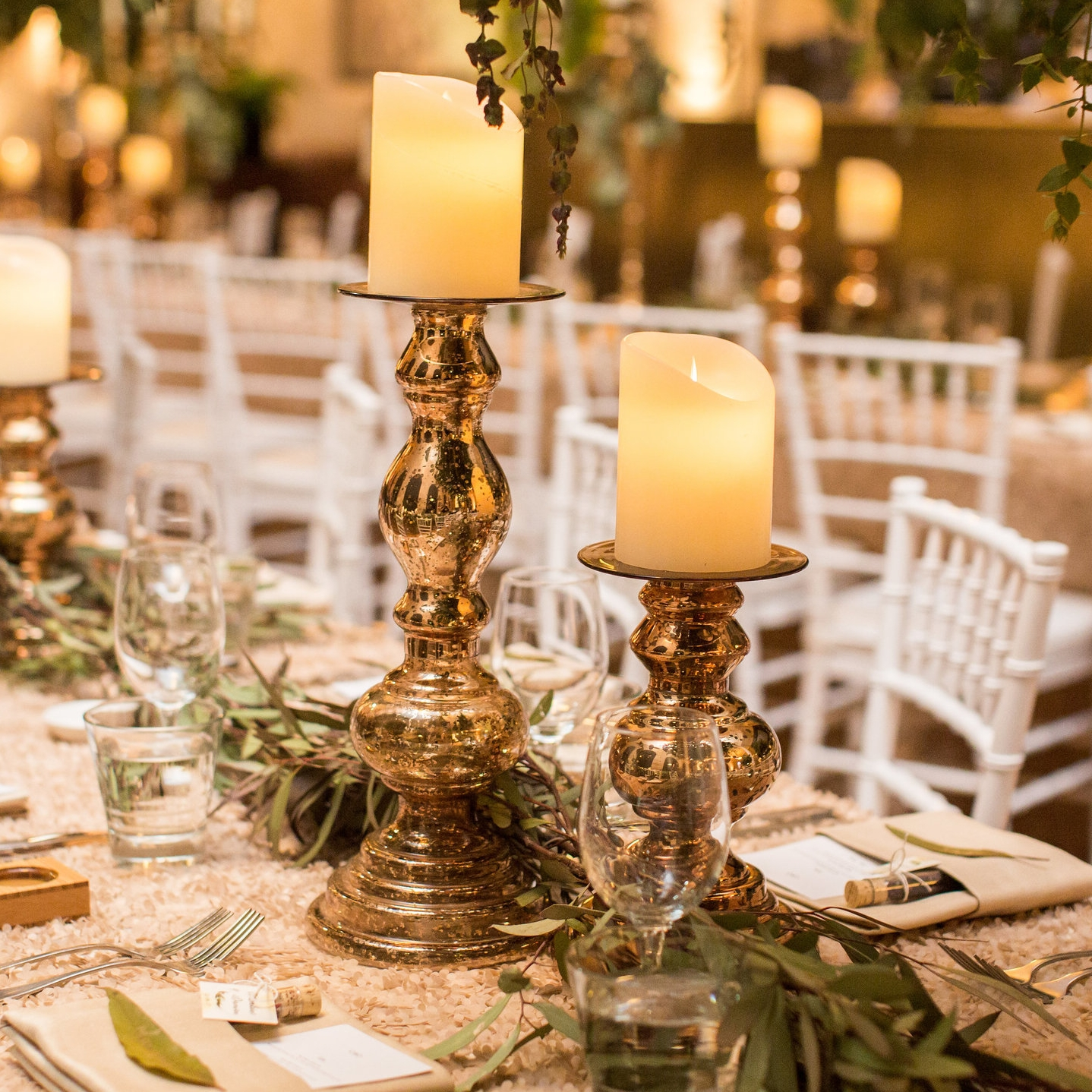 Columbine and Damien - Champagne Heather luxury linen, champagne napkins, gold Stefania candlesticks with LED pillar candles, white Tiffany chairs.jpg