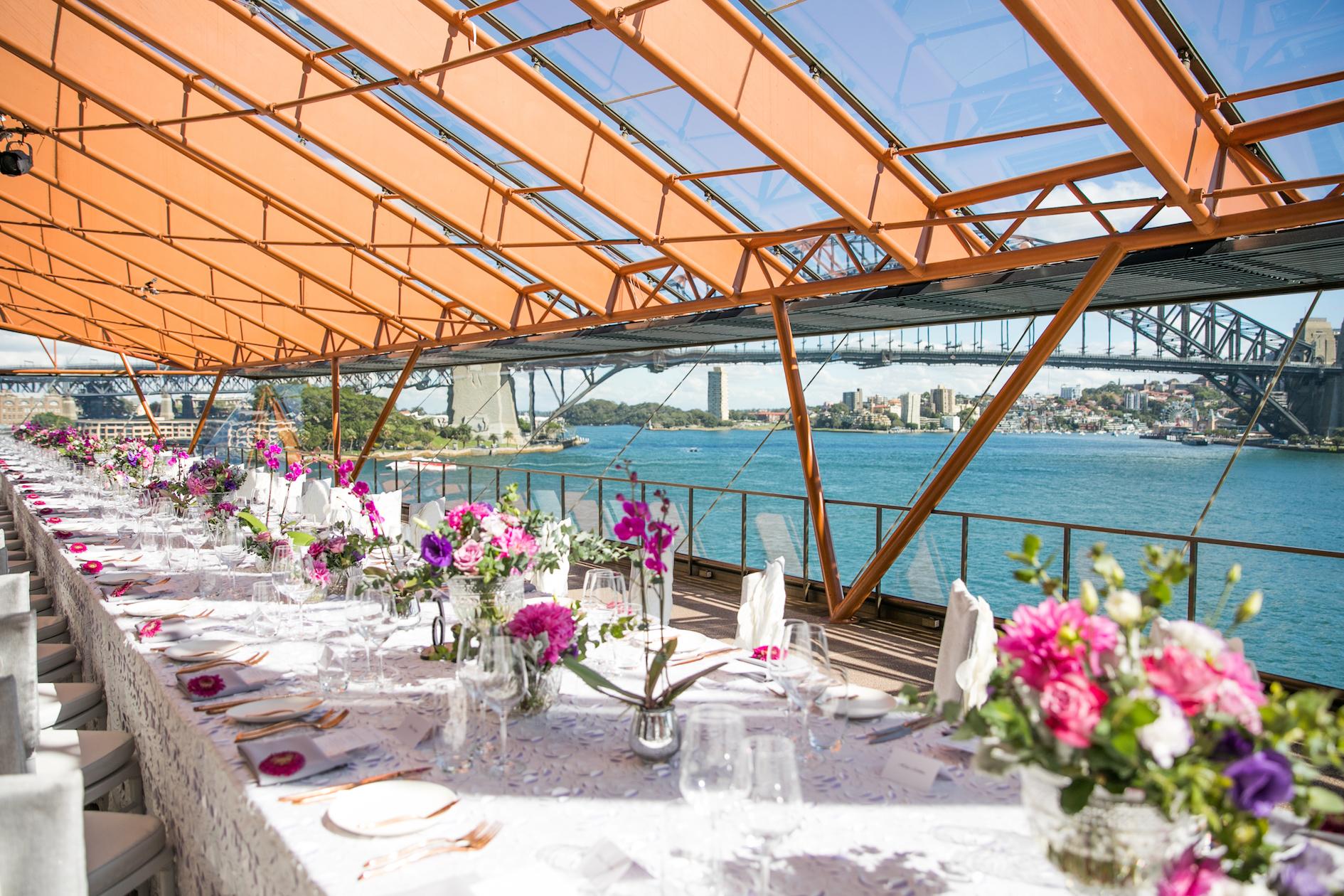 international_womens_day_sydney_opera_house_event_pink_purple_flowers_centrepiece.jpg