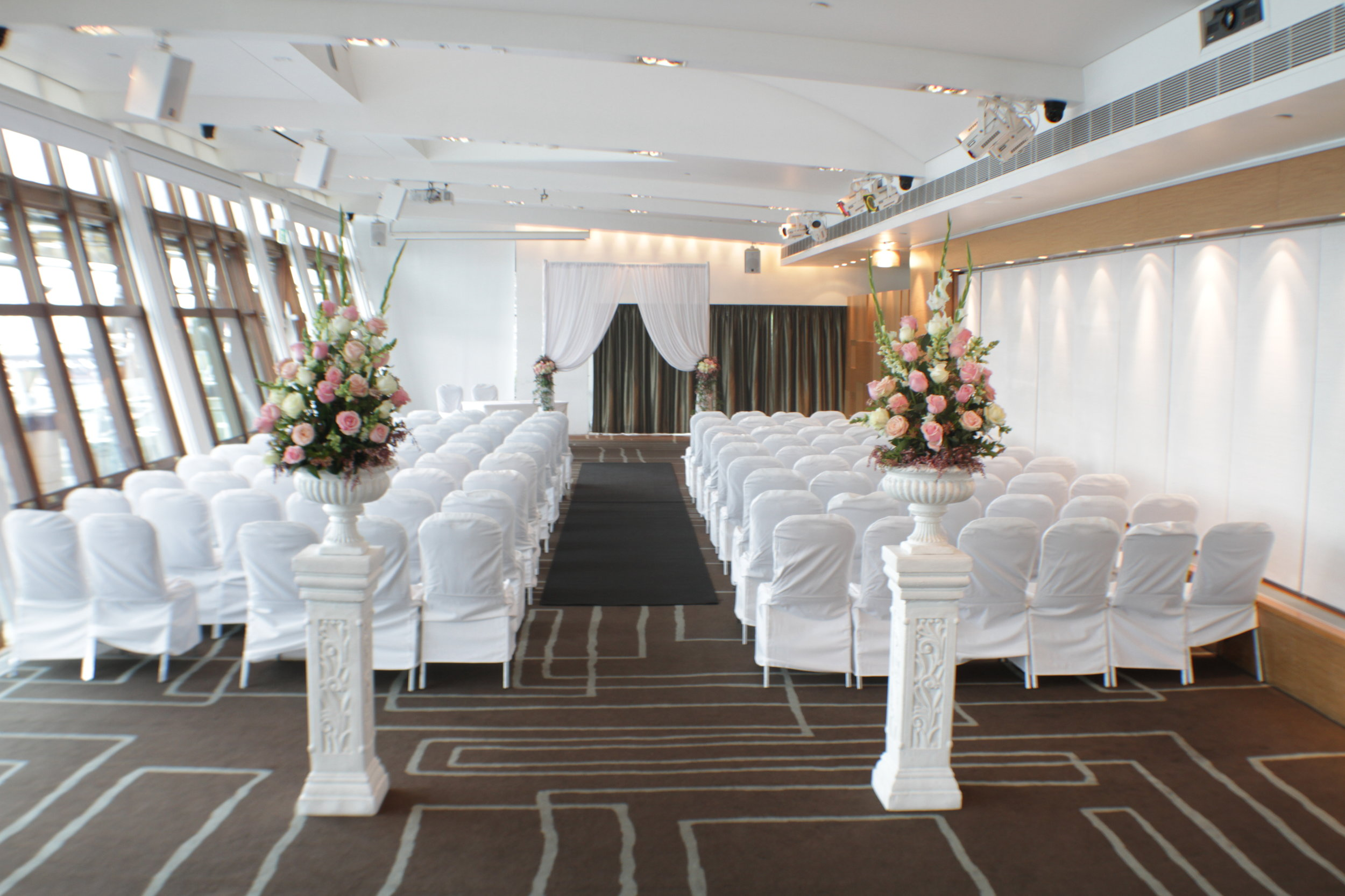 L'Aqua - Terrace Room - Ceremony - Half white chiffon canopy, black carpet and a set of 2 roman urn and pedestals with seasonal fresh flowers.JPG