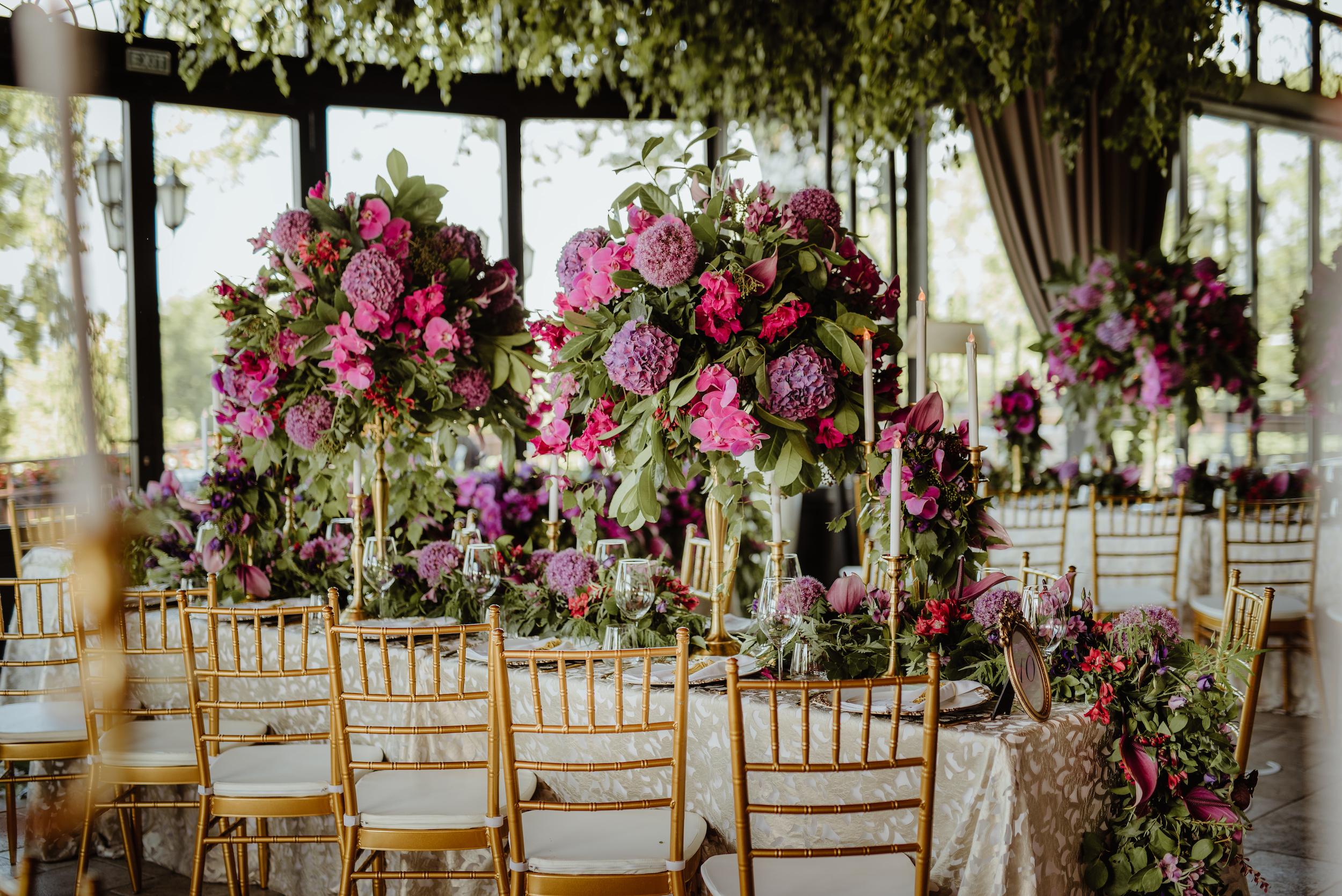 Indoor_garden_wedding_centrepieces_flowers_pink_purple_luxury_linen_king_table.jpg