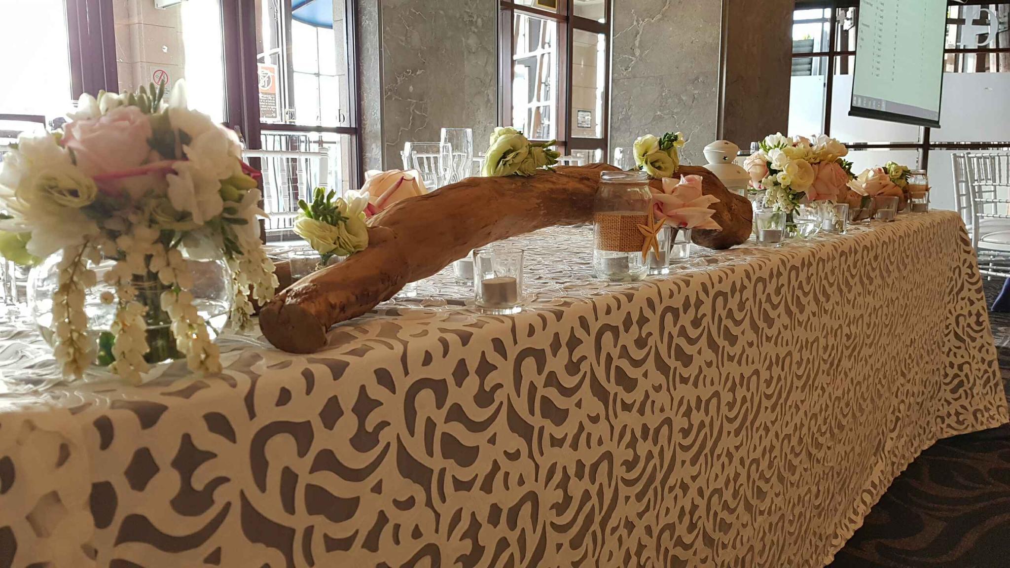 Bridal table- Luxury linen PB white Iris, fish bowl, timber log, with tealight candles .JPG