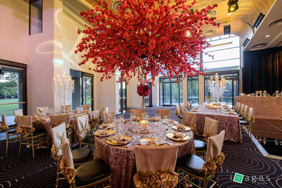 Waterview - Lake Room - PB Champagne Paisley tablecloths, Sofia gold chair caps, Gold KT stand with Silk Cherry blossom on top and fresh flowers on collar and gold accessories guest tables - Image 1.jpg
