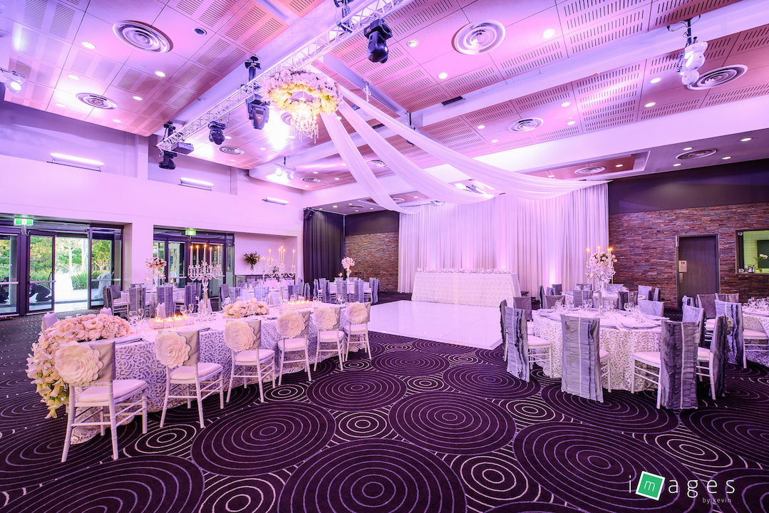 Waterview - Park Room -Set up consisting of crystal chandelier with silk florals, 3 flat roof draping, cascading floral runner on kings table, crystal candelabra, white madonna vases, PB White Fiori and Lori chair caps and Fiori tablecloths - 2.jpg
