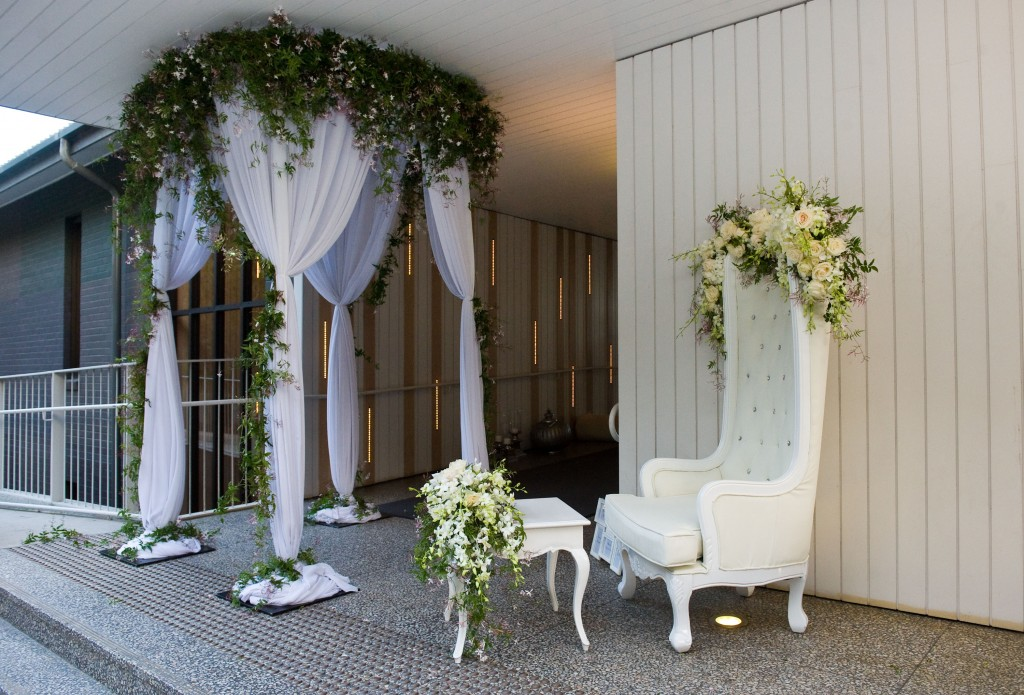 Round canopy with white chiffon with jasmine florals, King chair and white vintage table - Image 2.jpg