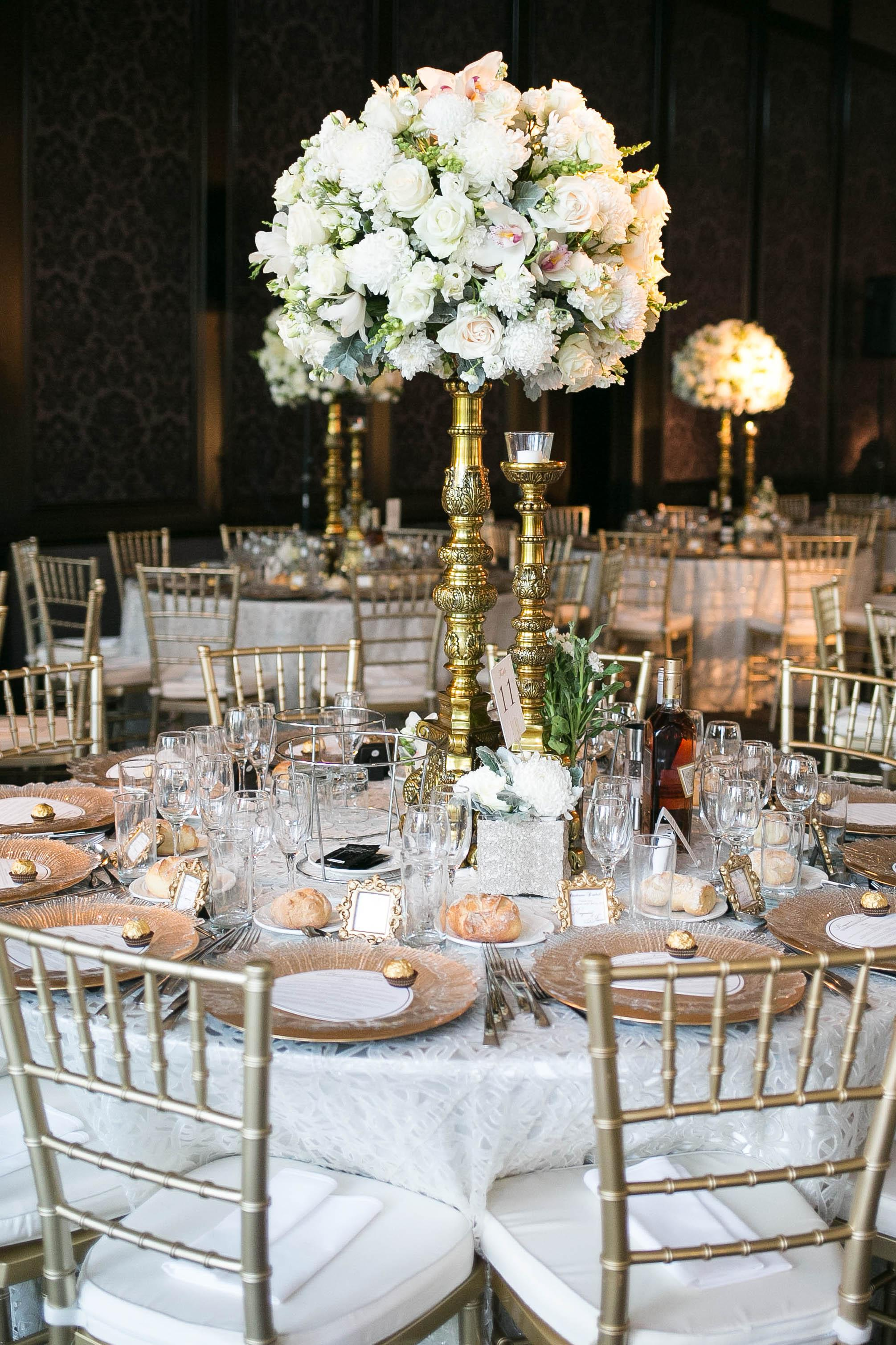 Curzon Hall - Preston Bailey Off white shimmer luxury linen tablecloths - round tables with gold tiffany chairs, gold plate and charger plate .jpg