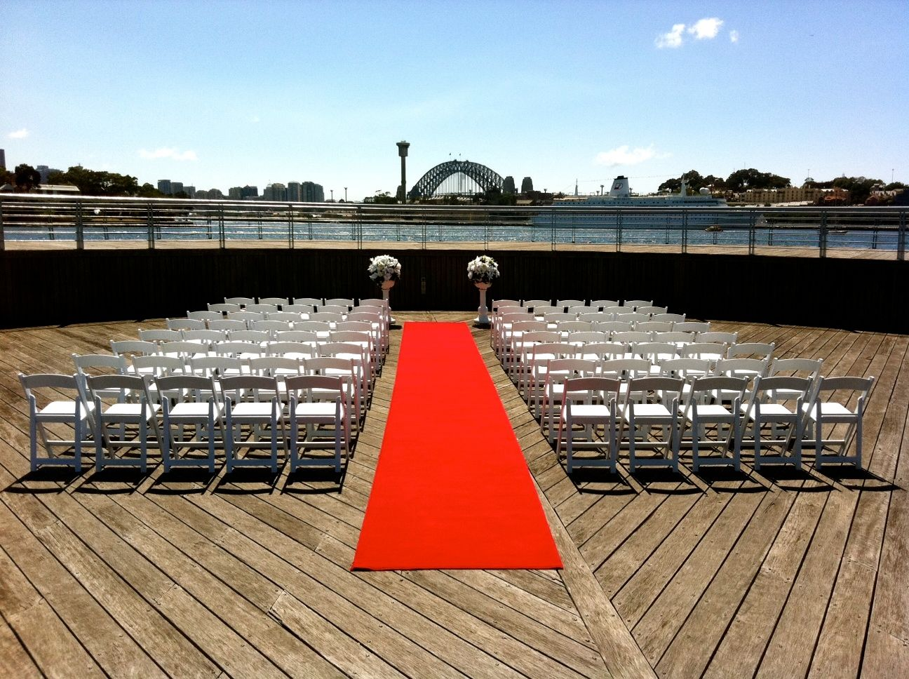 Pyrmont Point Park - The Lower deck - Red carpet, victorian urns with silk flowers and pedestals and fold up padded chairs - Image 1.jpg