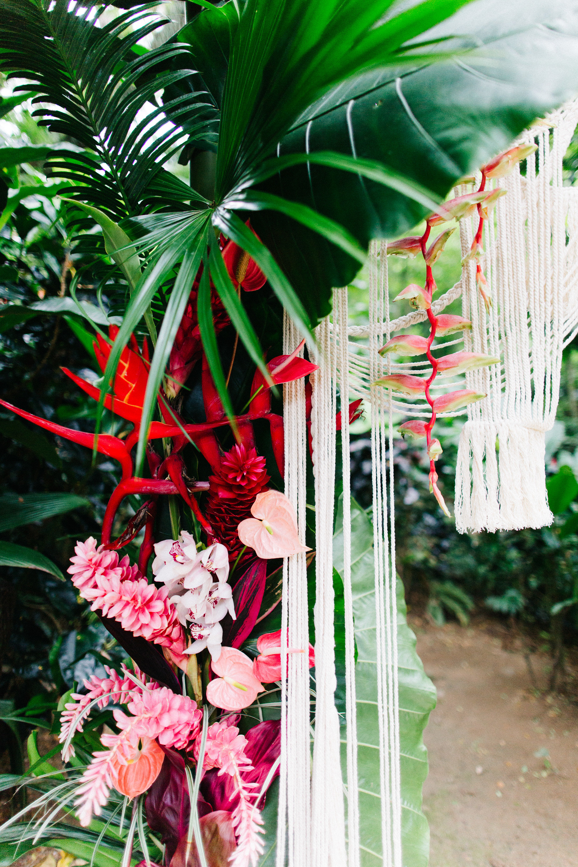 Fiji_destination_wedding_outdoor_ceremony_arch_fresh_flowers.jpg