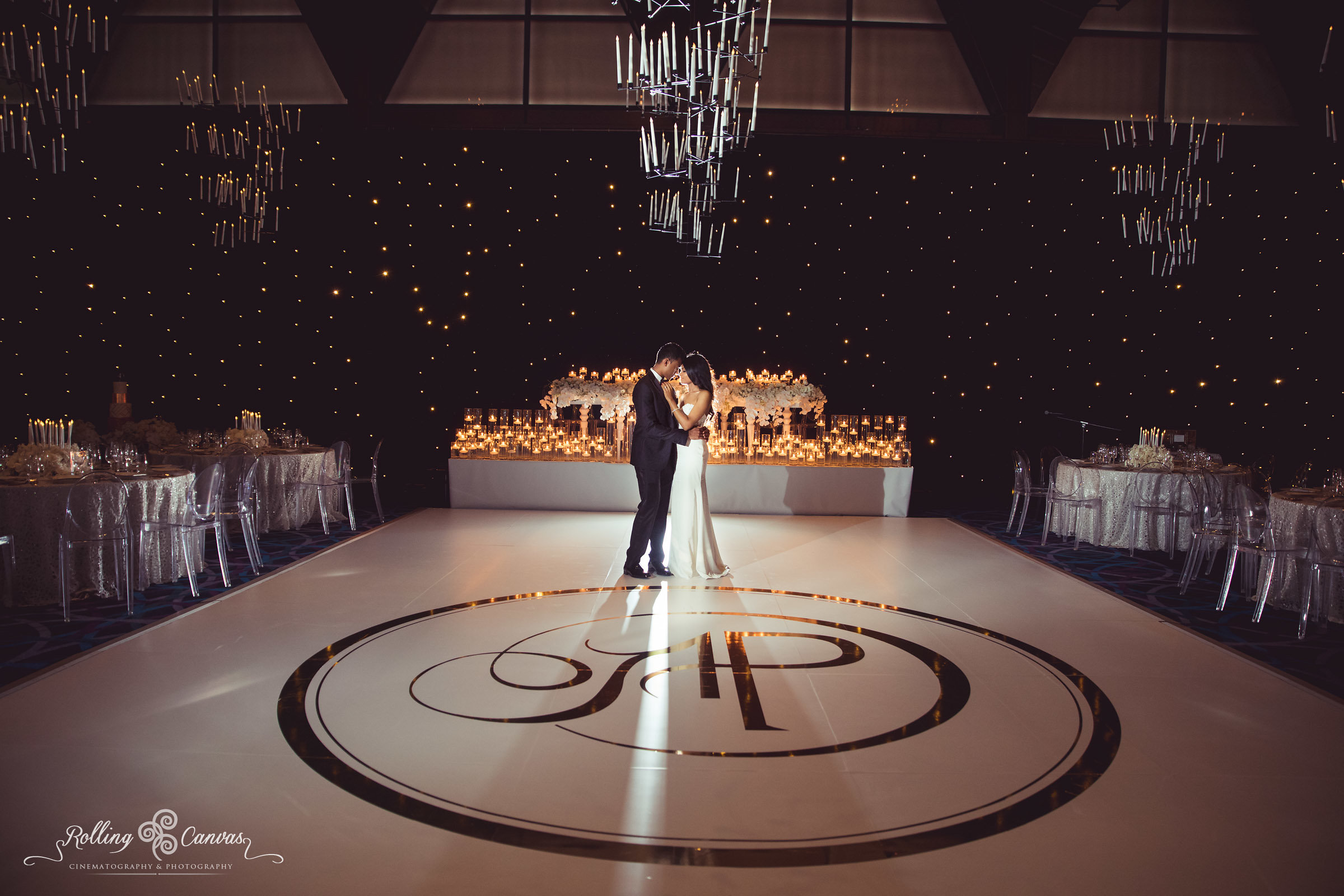 Wedding_Photography_Sydney_Rolling_Canvas_Presentation_black_white_elegant_reception_chandeliers_fairylights_white_dancefloor_luxury_linen_decor_Hyatt_Regency_Sydney-57242.jpg