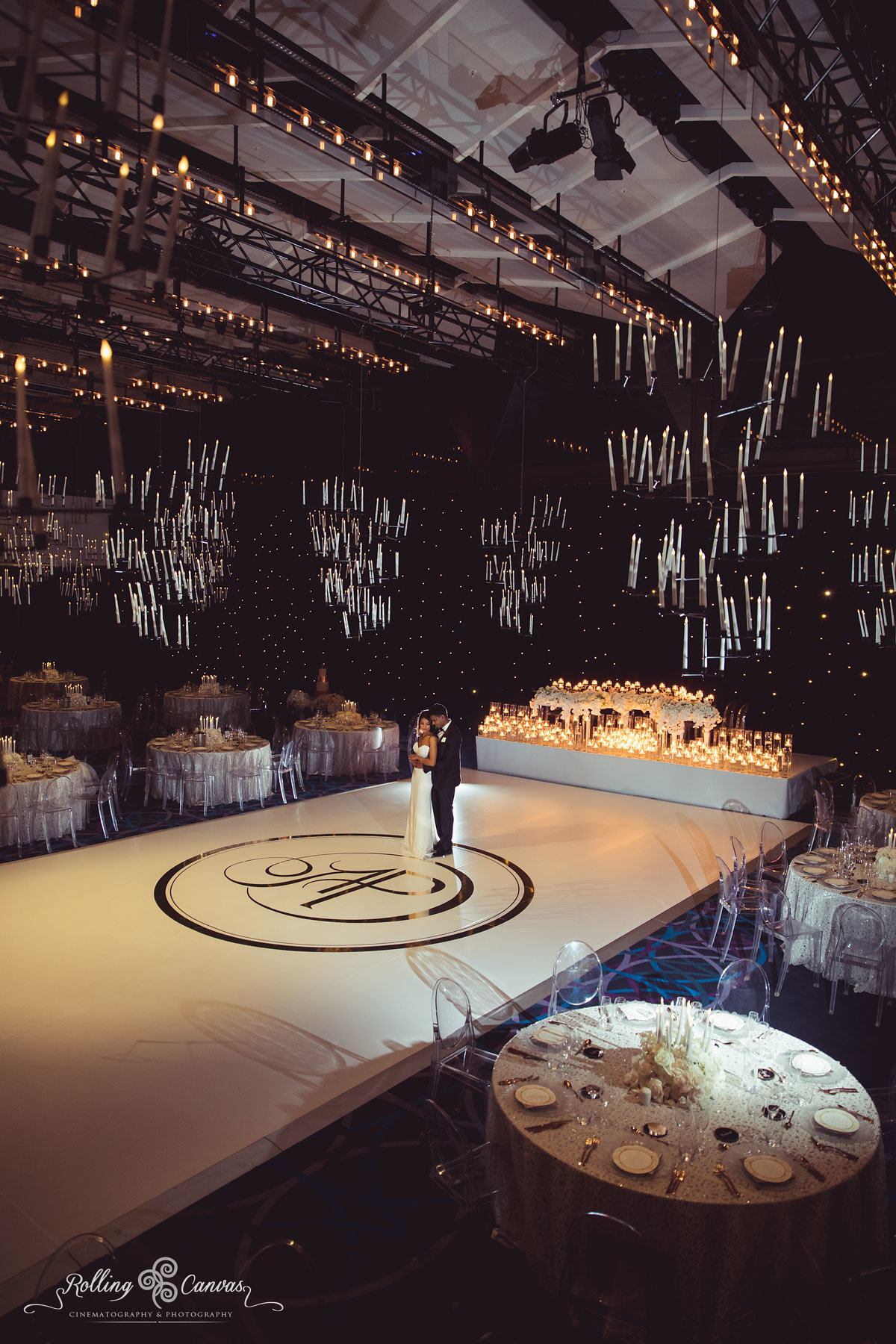 Wedding_Photography_Sydney_Rolling_Canvas_Presentation_black_white_elegant_reception_chandeliers_fairylights_white_dancefloor_luxury_linen_decor_Hyatt_Regency_Sydney-57249.jpg
