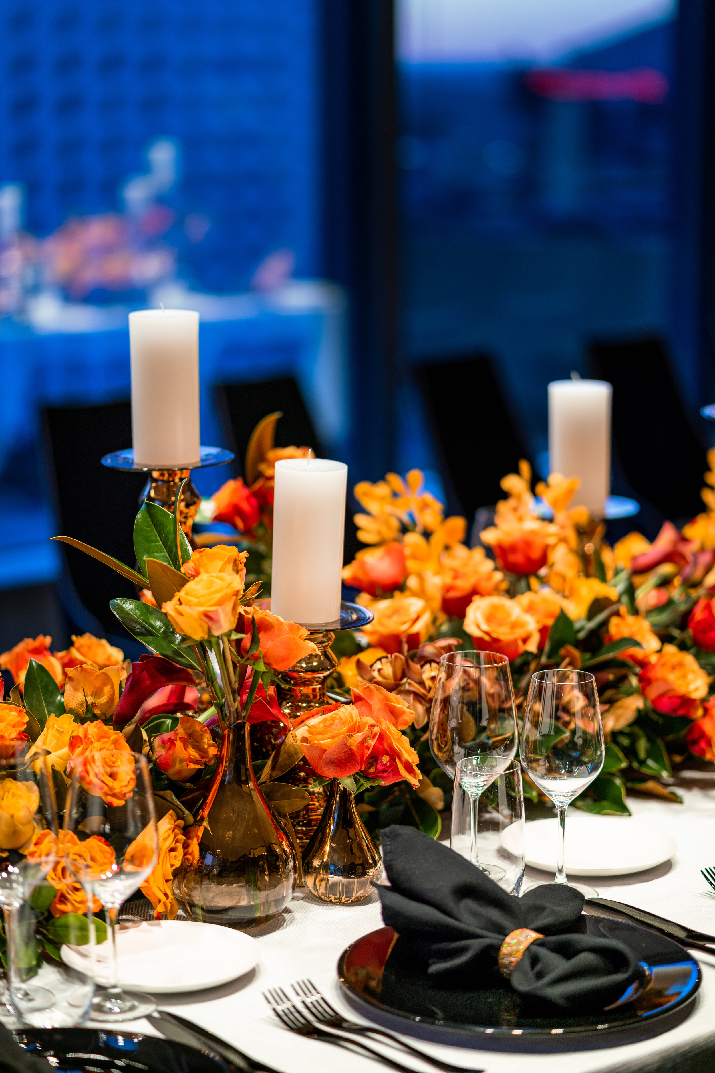 corporate_event_design_events_by_nadia_fresh_flowers_orange_inlighten_photography_black_charger_plate_cutlery_candle_stick_gold_napkin_ring_3.jpg