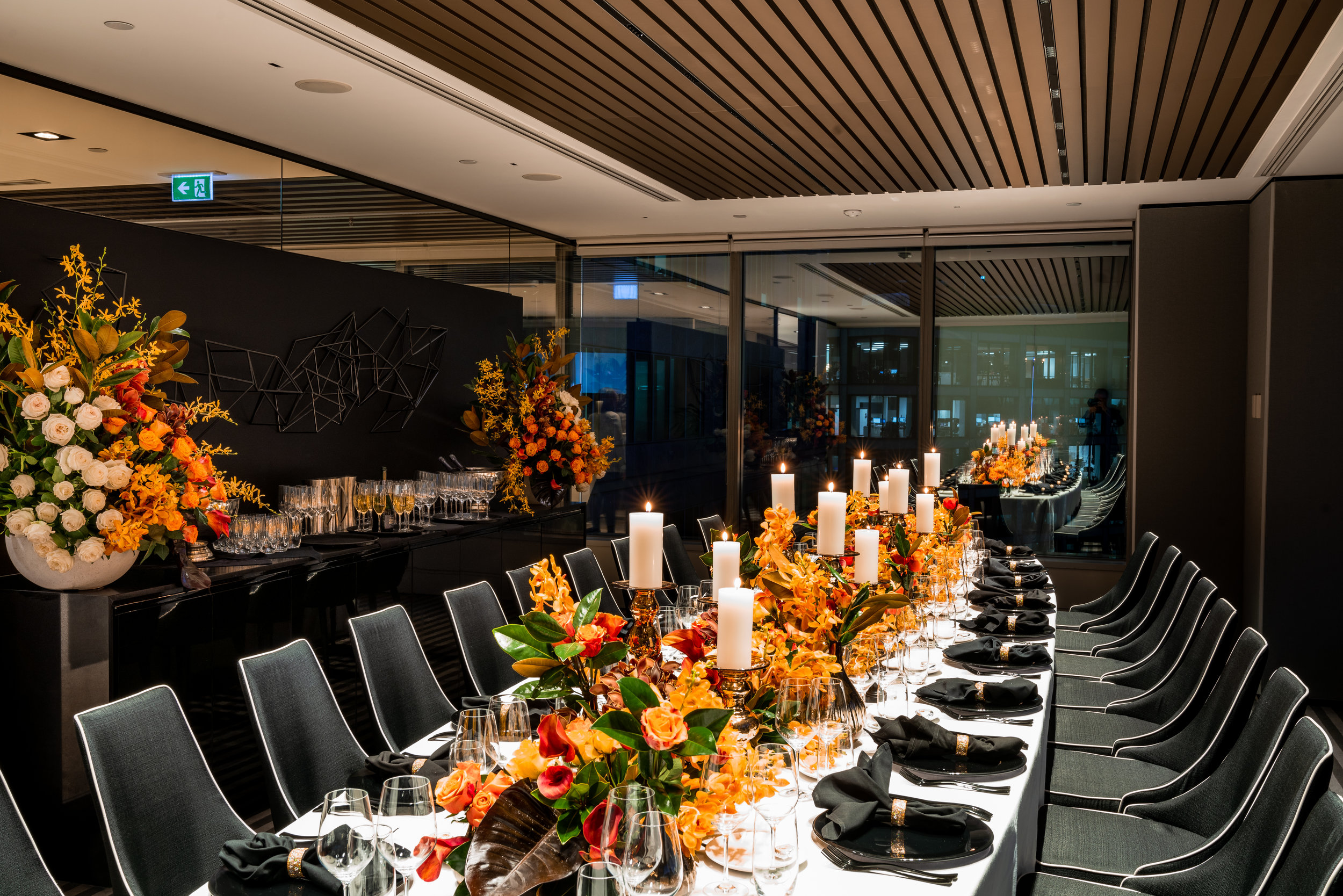 corporate_event_design_events_by_nadia_fresh_flowers_orange_inlighten_photography_black_charger_plate_cutlery_candle_stick_gold_napkin_ring_4.jpg