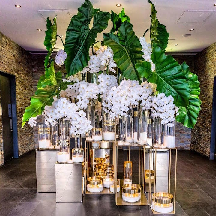 Waterview_entry_feature_gold_stands_fresh_flowers_candles.jpg