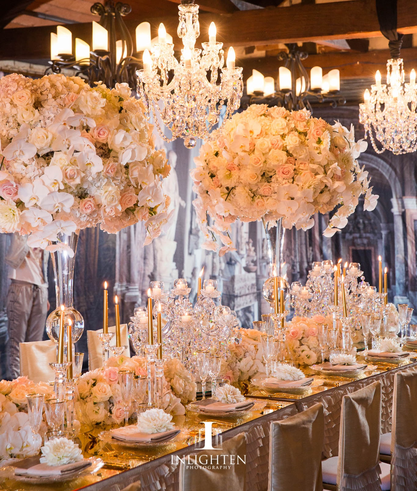 luxury linen_crystal chandelier_ centrepeice_ gold candles_crystal candleabra_champagne chair covers_crystal glasswear_crystal vase.jpg