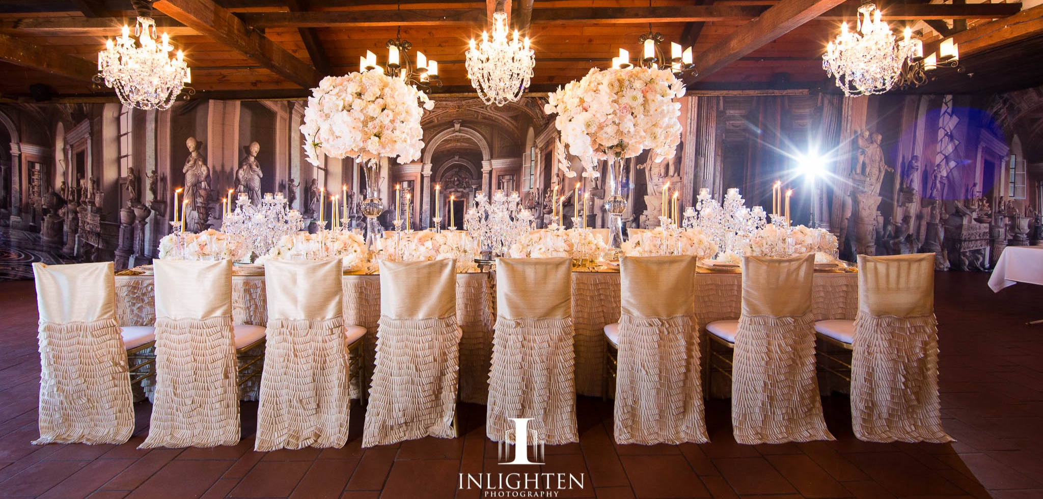 Champagne chaircovers_centrepiece_crystal chandeliers_italian inspired backdrop.jpg