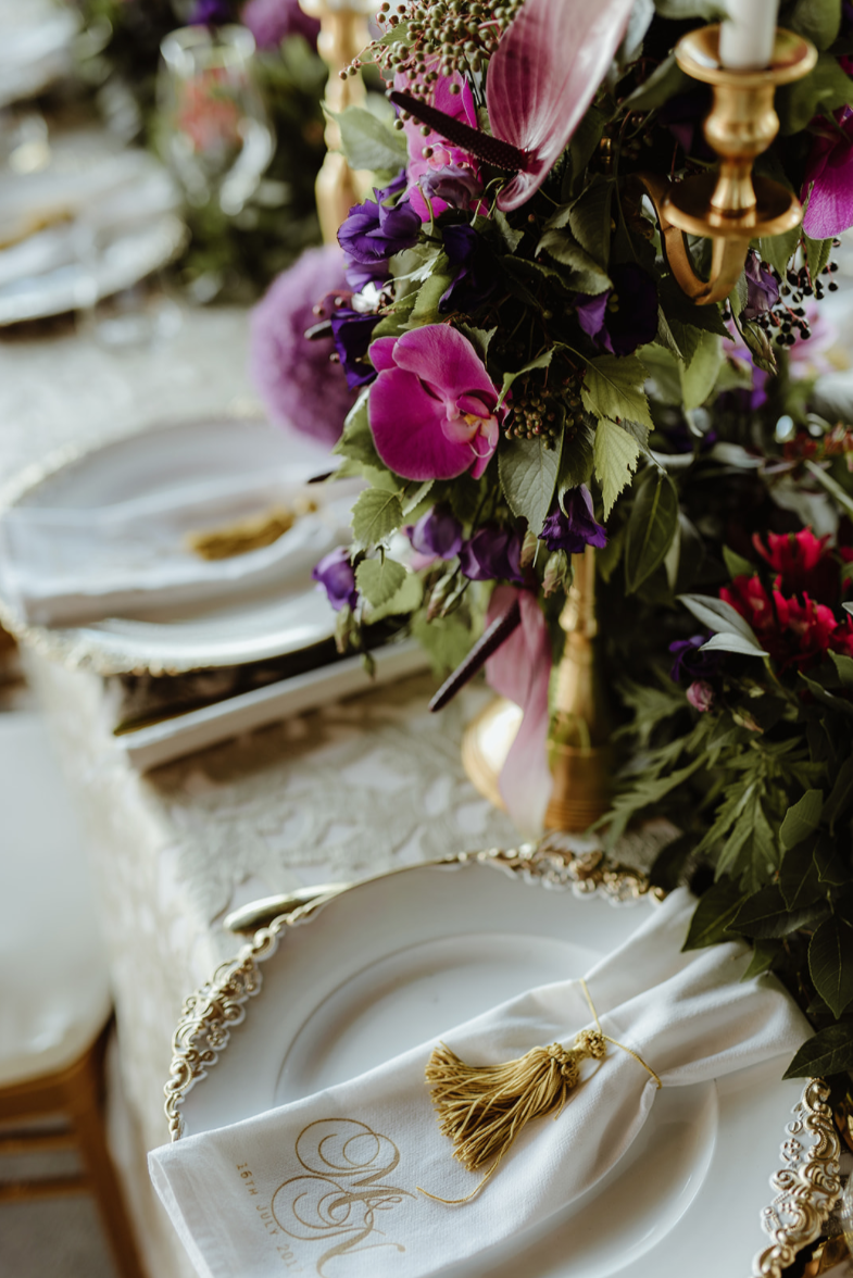 charger_plates_luxury_linen_napkin_gold_tassal_monogram_purple_centrepiece.png