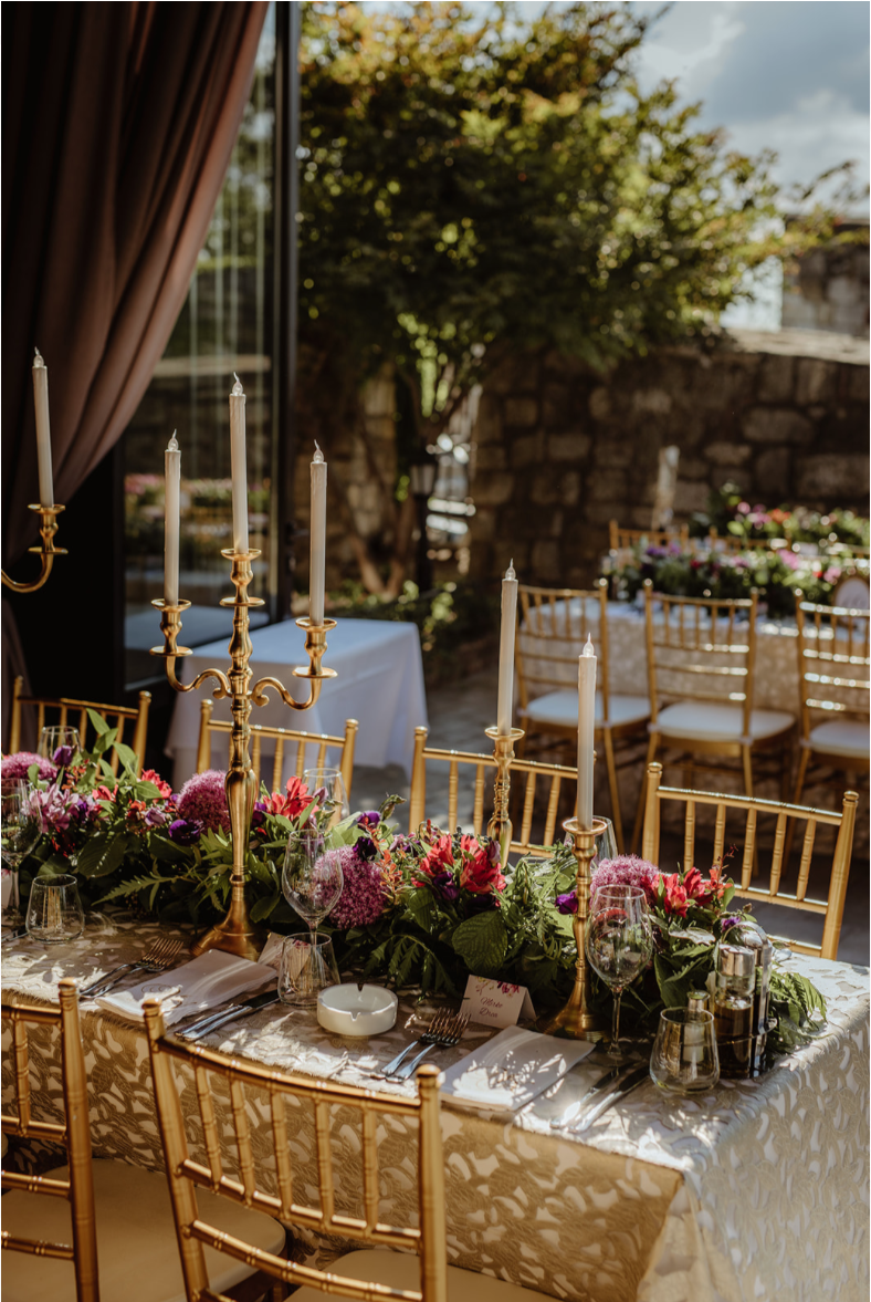 Gold LED_candleabra_gold_tiffanychairs_florals_luxury linen.png