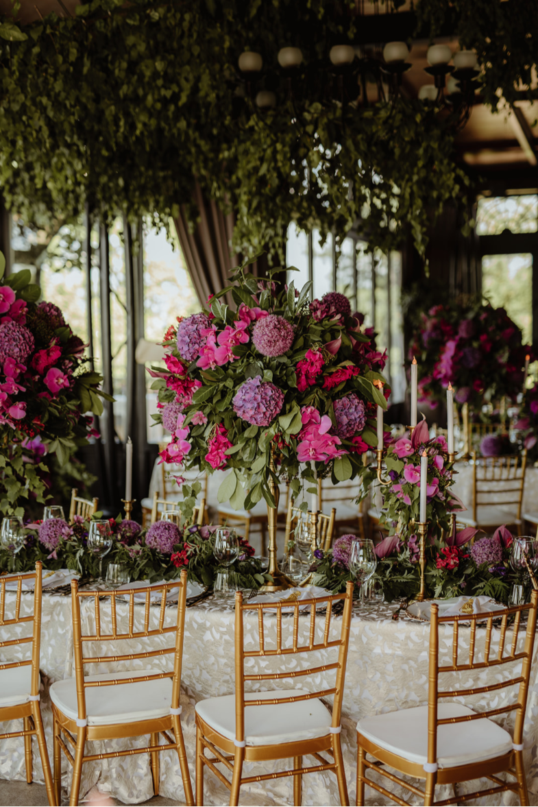 Gold_tiffany_chairs_luxury_linen_purple_centrepieces_floral runner_fresh flowers_LED candles.png