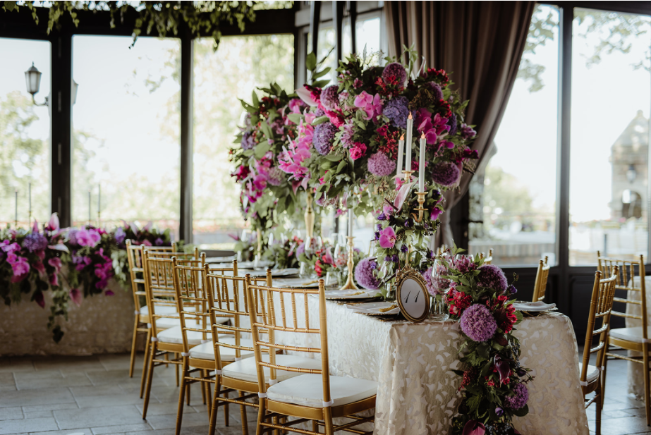 Long table_centrepieces_fresh purple florals_gold tiffany chairs_floral runners_luxury linen_gold table number_greenery.png