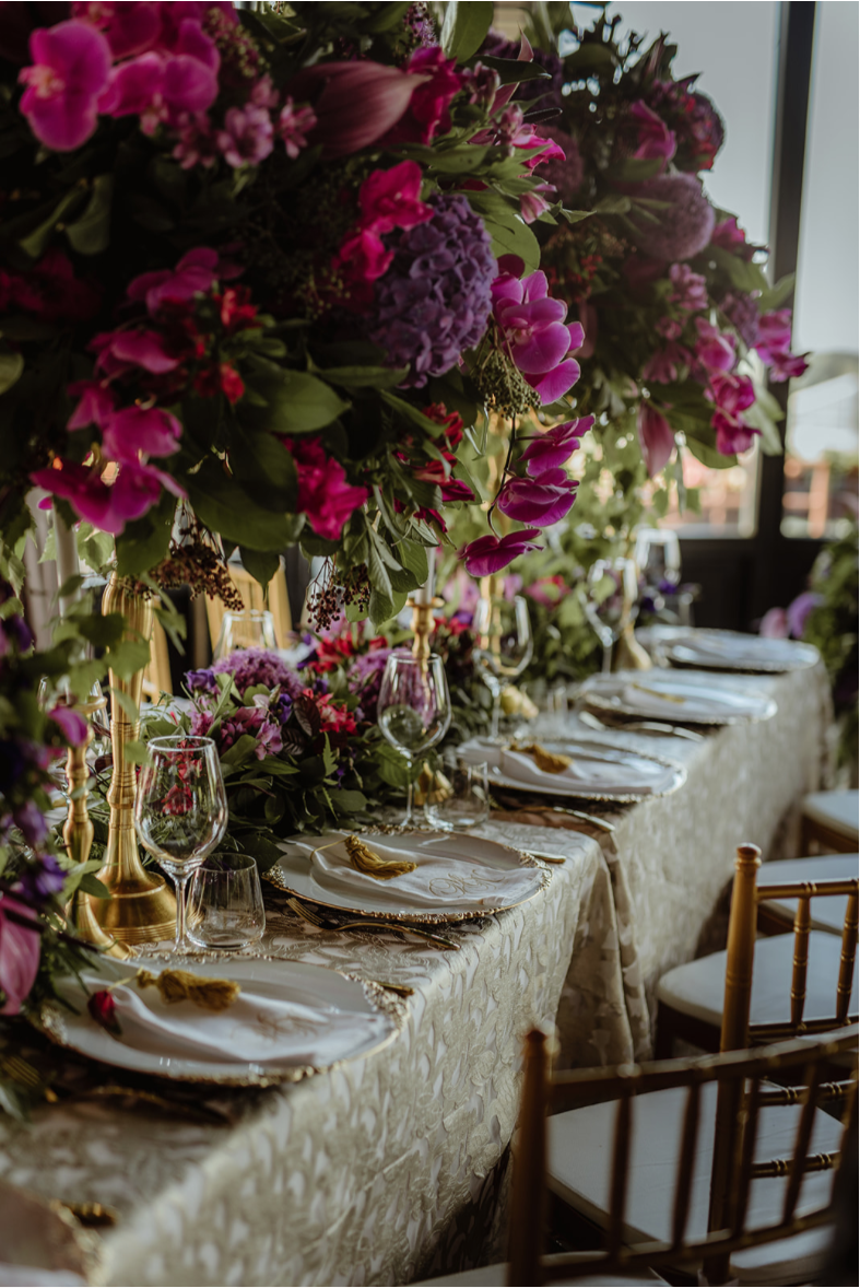 purple_floral_centrepiece_gold stands_luxury linen.png