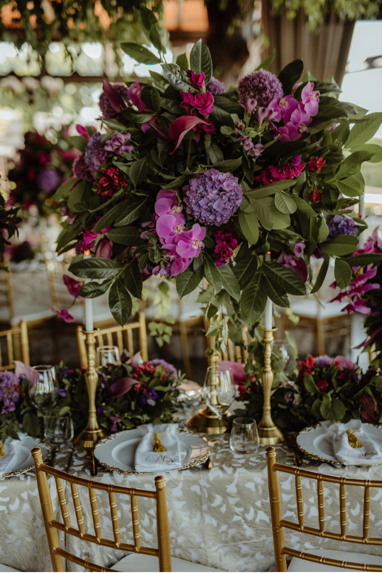 purple, deep pink_greenery_luxury linen_gold_tiffany_chairs_floral runner_gold candlesticks_LED candles.png