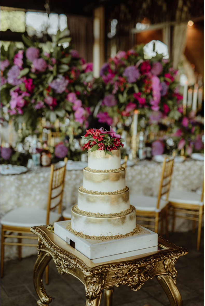 wedding_cake_11th_century_fortress_purple_flowers_centrepiece_gold_cake_table.png