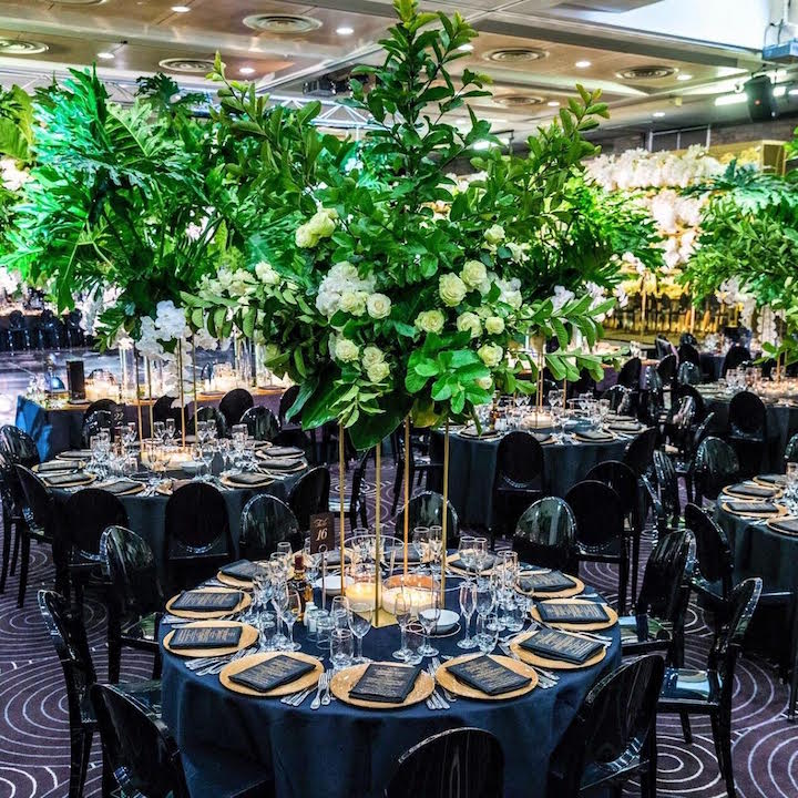Waterview_flowers_floral_green_wedding_centrepiece_black_gold_carly_stand_charger_plates.jpg