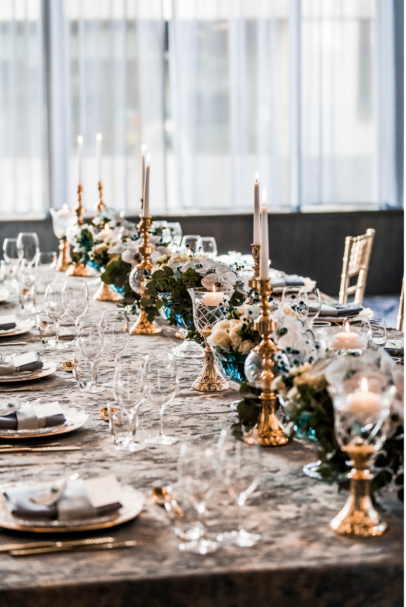 slate_plaster_luxury_linen_wedding_decor_sydney_tablecloth_blue_gold_theme_candles_table_setting_inlighten_photography.png
