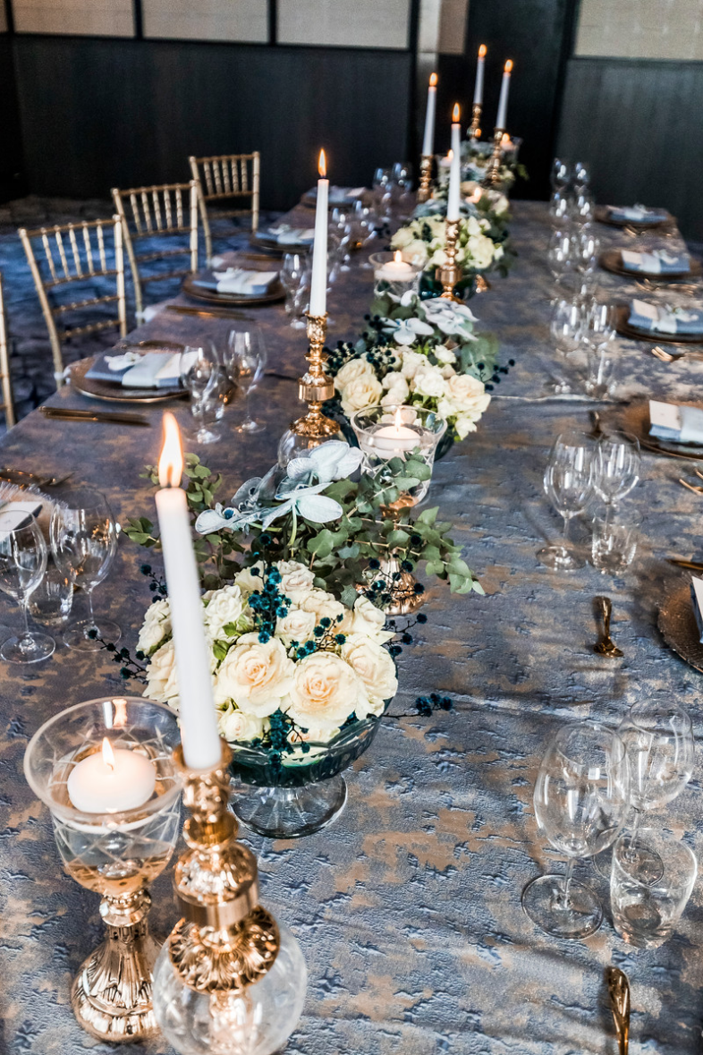 slate_plaster_luxury_linen_wedding_decor_sydney_tablecloth_blue_gold_theme_white_flowers_inlighten_photography.png