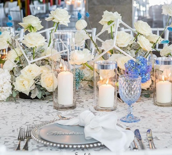 White_anita_blue_underlay_silver_charger_plate_blue_theme_candles_white_flowers.png