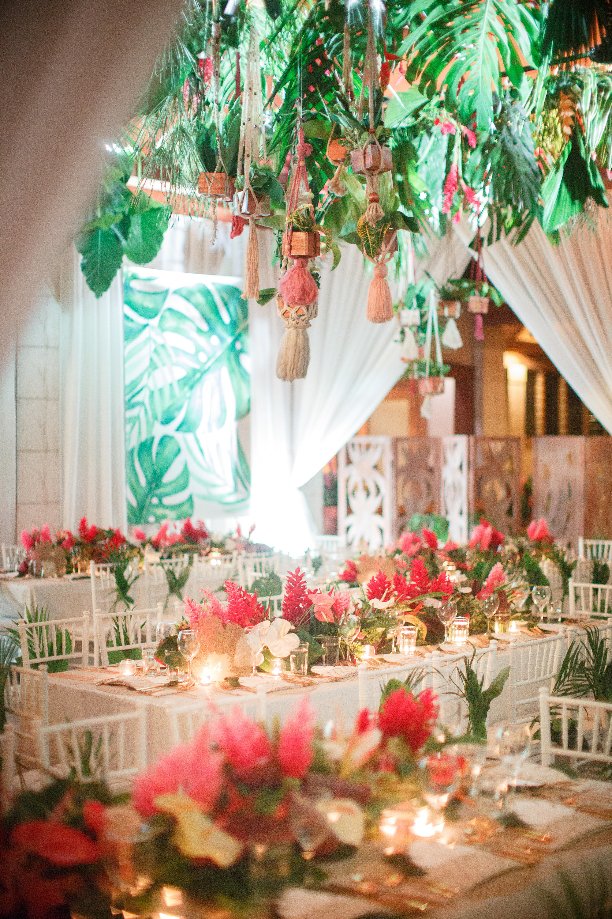 Fiji wedding - luxury linen, gold cutlery, centrepieces, white tiffany chairs, hanging macrame and pot plants.jpg