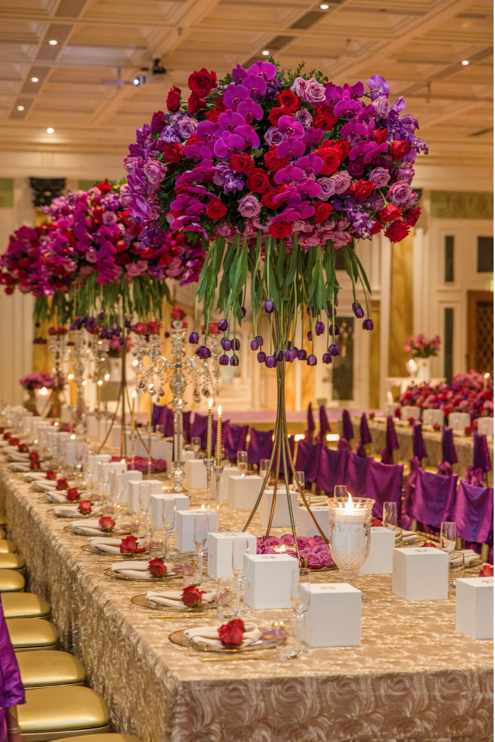 Hire_gold_emma_luxury_linen_sydney_wedding_decor_king _table_centrepeices_purple_roses.png