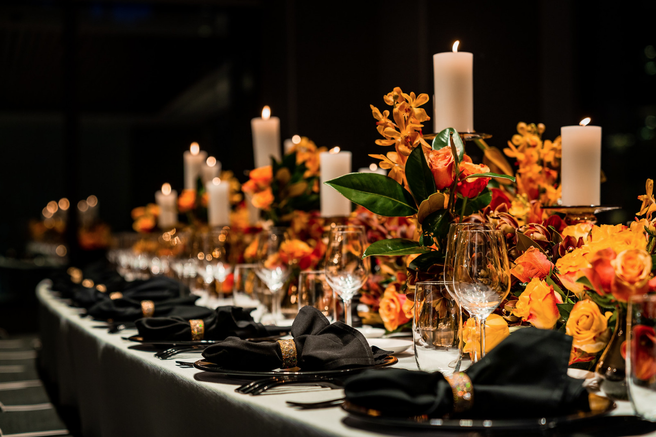 corporate_event_design_events_by_nadia_fresh_flowers_orange_black_charger_plate_candle_stick_gold_napkin_ring.png