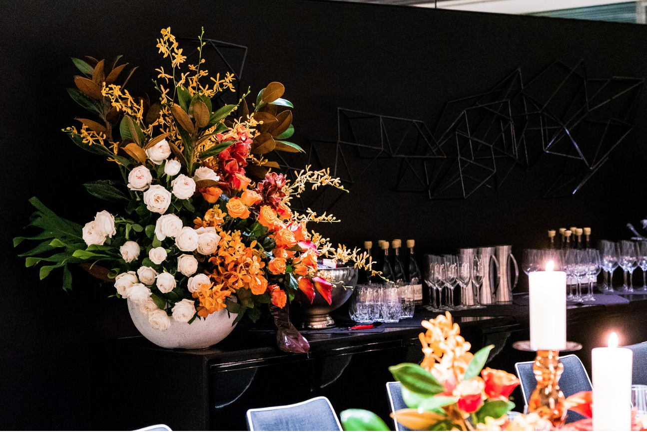 corporate_event_design_events_by_nadia_fresh_flowers_orange_inlighten_photography 1.png
