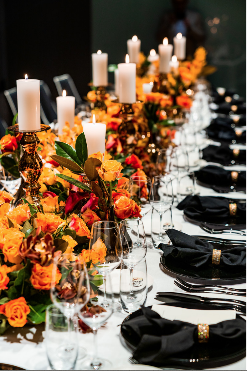 corporate_event_design_events_by_nadia_fresh_flowers_orange_inlighten_photography_black_charger_plate_cutlery_candle_stick_gold_napkin_ring_crystal_glasswear.png