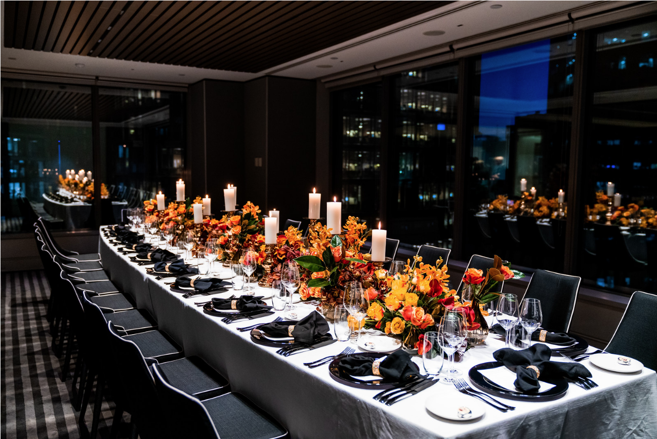 corporate_event_design_events_by_nadia_fresh_flowers_orange_inlighten_photography_black_charger_plate_cutlery_candle_stick_gold_napkin_ring_king_table 3.png