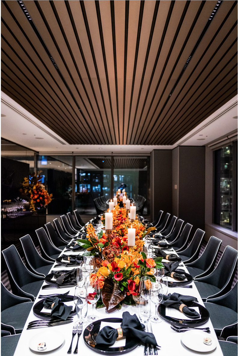 corporate_event_design_events_by_nadia_fresh_flowers_orange_inlighten_photography_black_charger_plate_cutlery_candle_stick_gold_napkin_ring_king_table.png